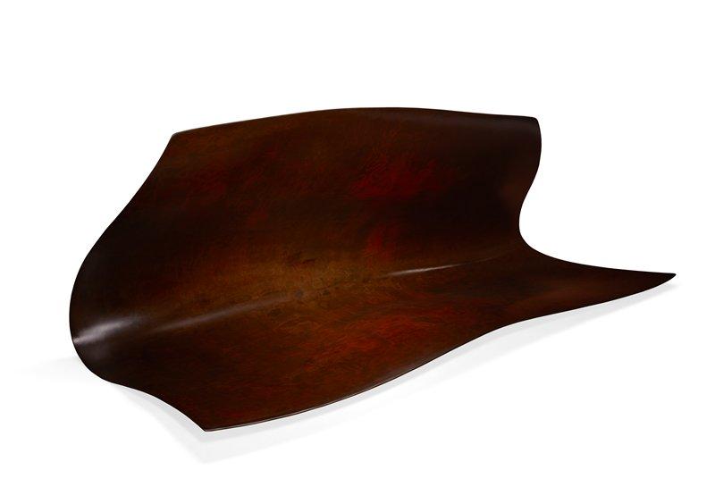 "large, ""folded-over"" organic form, asymmetrical design; dark brown, wood grain texture"