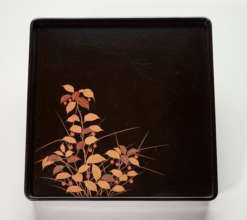black lacquer tray decorated with leafy plant with red berries