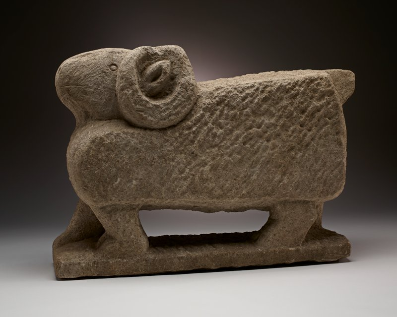 pale grey stone; standing ram with blocky body; curling horns; stubby, blocky tail