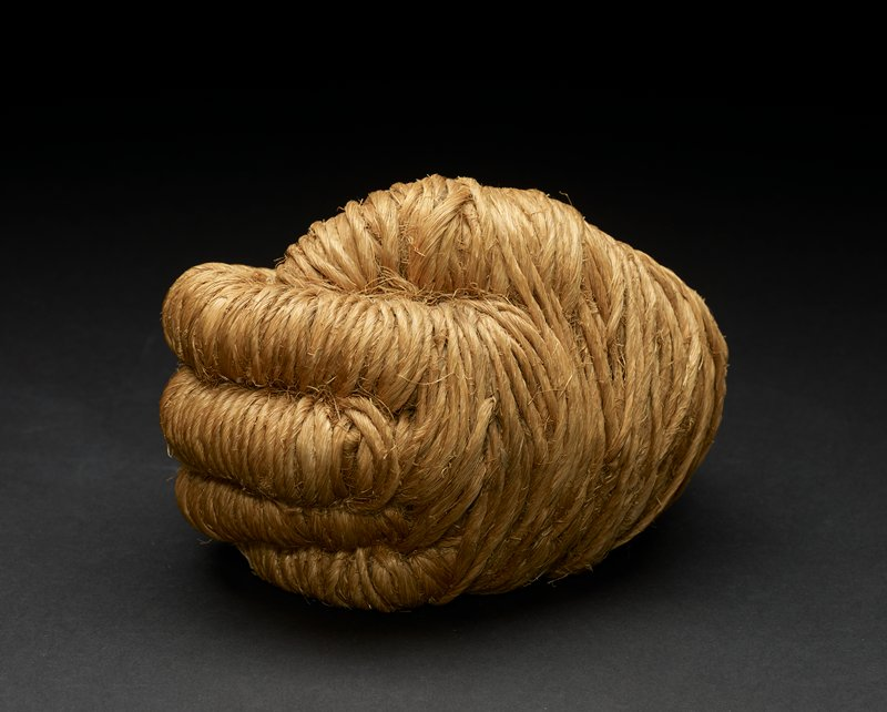 Jute is wrapped and formed into a circular form with a hole in the center, resembling a fist