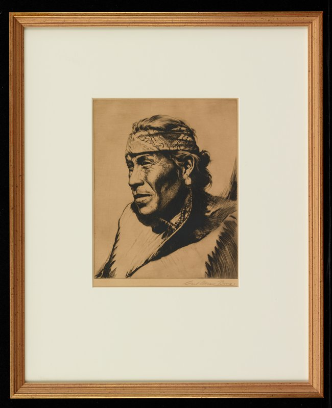 portrait of a Native American man wearing pendant earring, bandana tied around his head and beaded necklaces