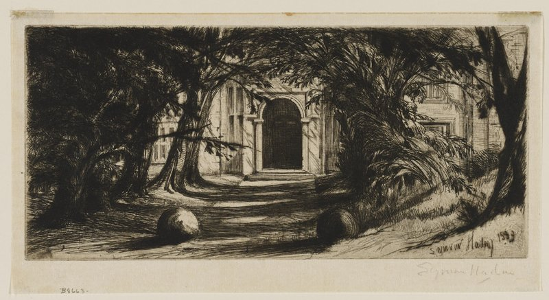 tree-lined sidewalk leading to the arched doorway of a large white building; large stone balls flank either side of the path