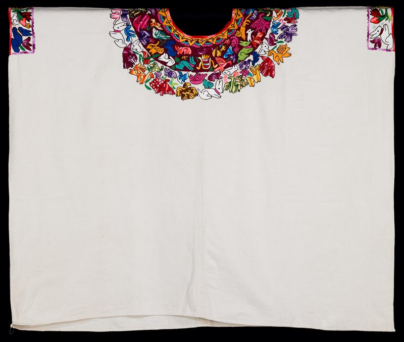 """One-panel huipil of white cotton commercial fabric; round-cut neck opening; hand-sewn hem at lower edge. Yellow, rayed sun embroidery circles neck opening; burgundy embroidered area 3 1/2"""" wide provides background for upper half of pattern; highly abstracted animal and bird figures embroidered with hombre floss in non-realistic colors encircle the sun border. Figures include peacocks, quetzal, owl?, misc. mythological birds; rabbits, fox?, cat? other highly stylized animals, real and imagined."""