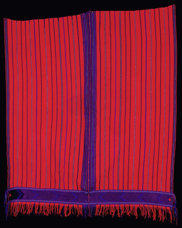 2 panels sewn together; red fabric with thin stripes in blues, green and purple; brocaded band at bottom in blue, black and purple; fringe on top and bottom of brocade band and on one end