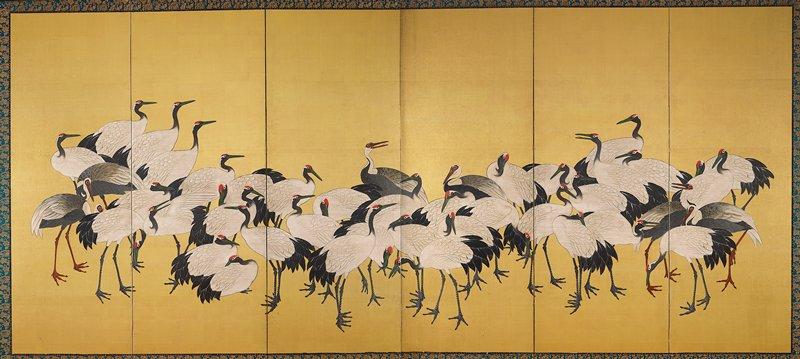 large flock of cranes, with a few darker gray cranes against a gold background