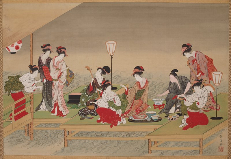 male figure in gray and white striped kimono grabs the wrist of a young female attendant who was handing him a red dish; other young women and geisha serve tea, play instruments, and dance around the man; small feast in front of man on ground, including large red snapper; scene takes place on a green dock over water