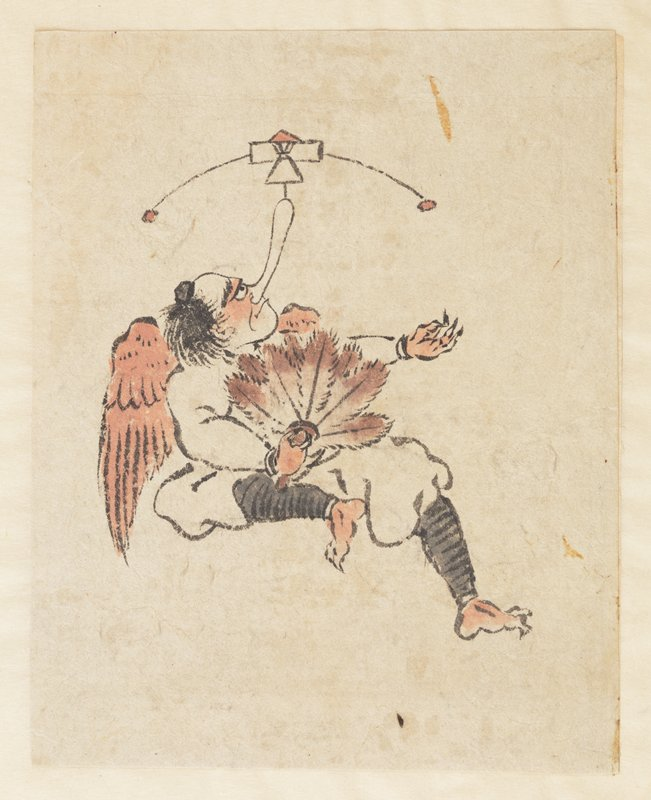 male figure with wings, seated, balancing object with two small balls on his large nose; figure holds fan made of feathers in PR hand