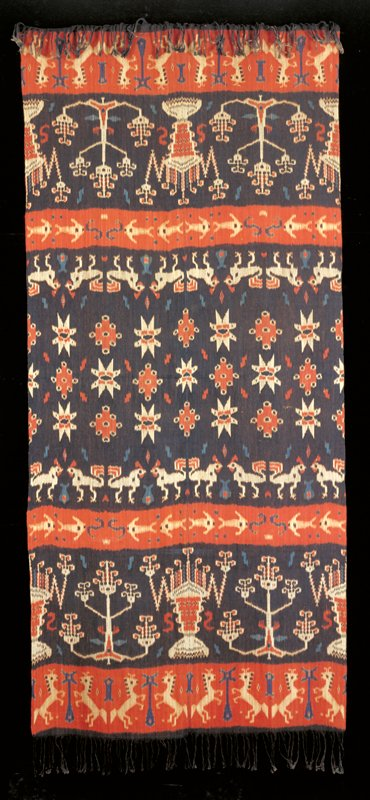 Cotton warp ikat; 2 panels sewn together with brown ground; geometric shapes and rows of roosters, fish and bucking horses in white, orange and blue