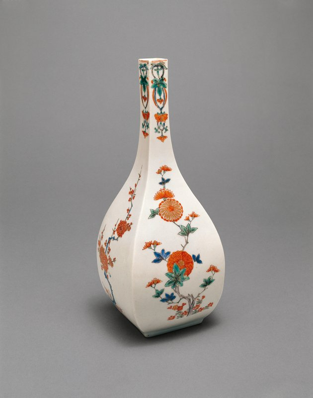 bottle with square base and narrow, square mouth; delicate designs of chrysanthemums and cherry blossoms on alternating faces; red, green, blue coloring on white