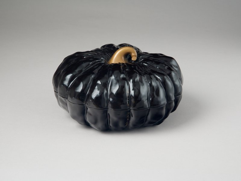 box in the shape of a round, fluted gourd, possibly with a gourd as core; black lacquer with sprinkled gold on the stem