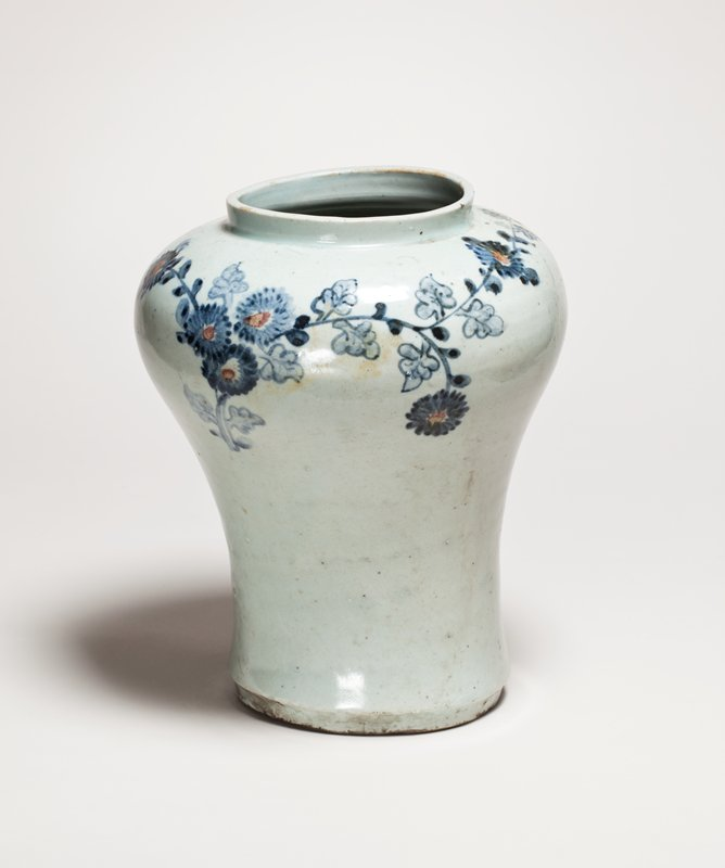 light blue vase with narrow foot and wide shoulder; slightly lopsided; trailing chrysanthemum design around shoulder with blue flowers; bamboo sprigs on opposite side