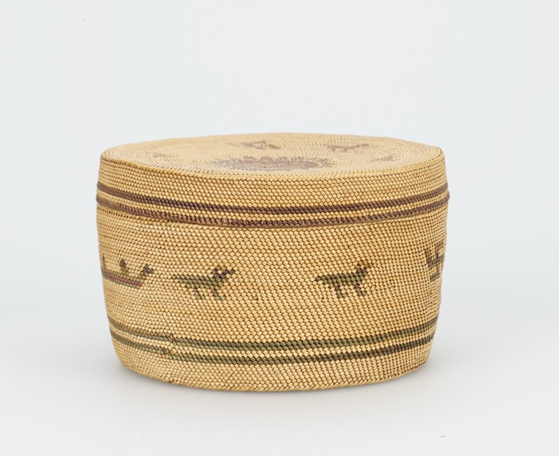basket and lid with swastika bird and canoe motifs in light and dark brown; sun symbol on center of lid