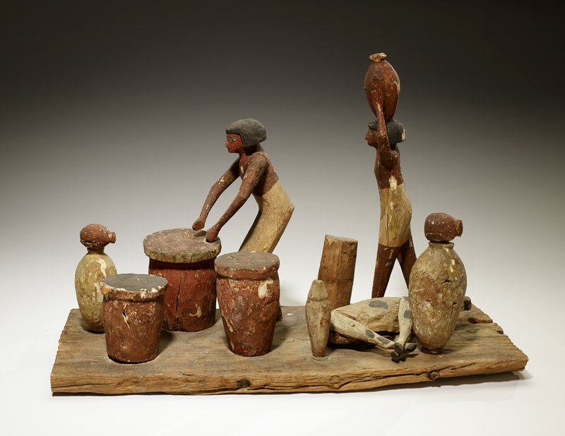 Servant model, red white and black; Group of 3 Figures (depicts slaughtering), wood,Egyptian Dynasty X-XII cat. card dims L. 18', W. 20', H. 12-1/4'