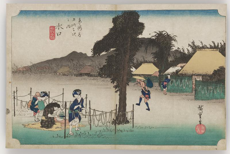 open field with several women working near tree; one woman is cutting thin spirals from a white vegetable, with the other two are hanging the white strips on string fences; huts at R with more white strings; man walking between the working women and the huts