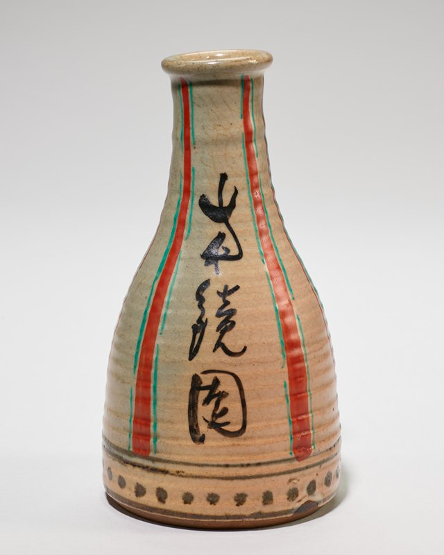 Sake Bottle fine brown paste, covered with gray to pinkish glaze and decorated with red and green vertical stripes and inscription.