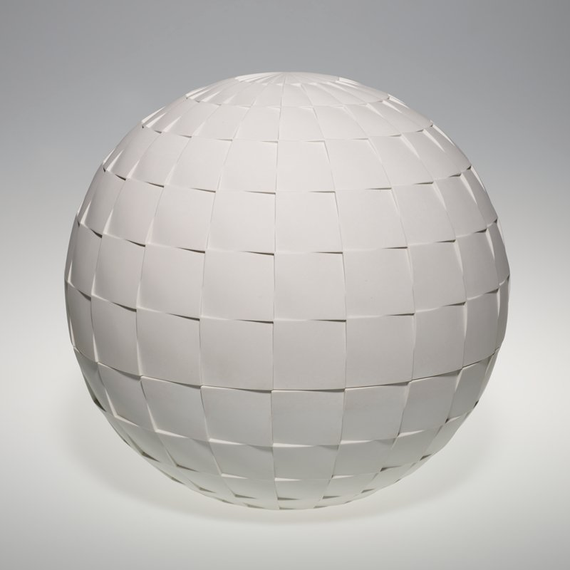 white sphere that is divided into two halves; concentric layered square pattern across the surface