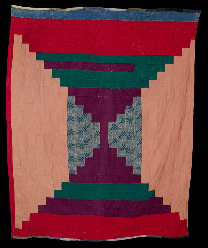 rectangular stepped strips in pyramid designs--two dusty rose with patterned blue at top, two in purple, red, green, and blue; heavy twill, denim, and corduroy materials; patchwork back with large rectangular pieces of similar fabric, including plaid flannels; no heading band or sleeve