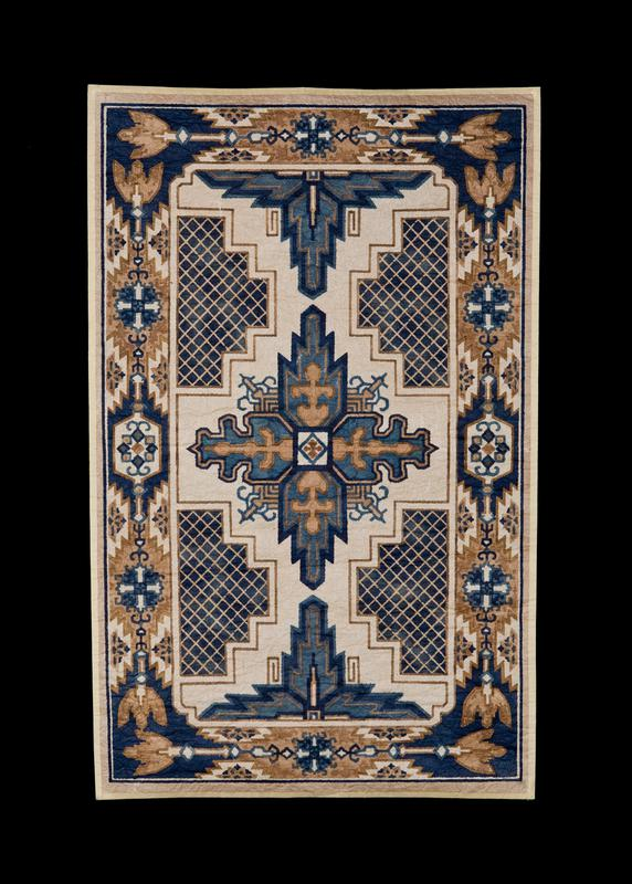 paper mat with tan background, with ornamental design in blue and tan pigments; ornamental border, with inner design of four stacked shapes on both R and L sides, with blue pigments and a lattice pattern inside shapes; blooming, geometric design in center, with dark blue edging, and tan geometric shapes