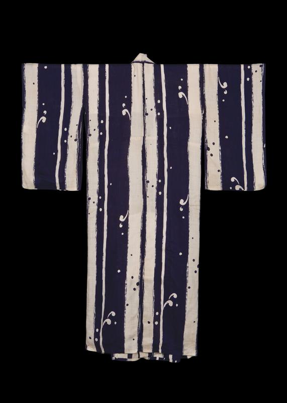 blue and cream-colored kimono, with vertical stripes that resemble brushstrokes; small circles and 'comma' shapes scattered throughout