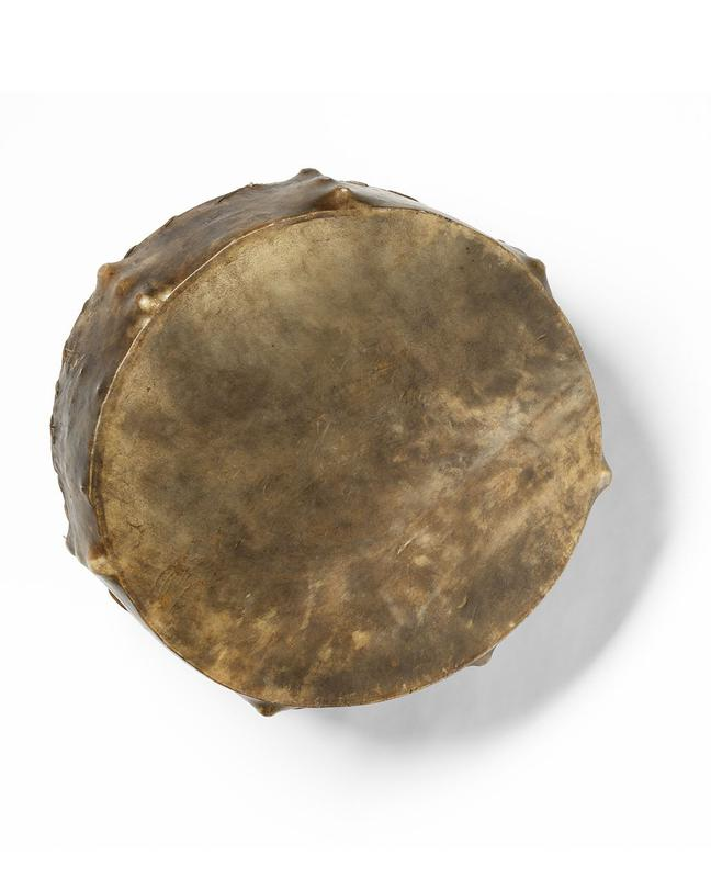 large round drum; inner wooden cross bar carved with thin, diagonal lines