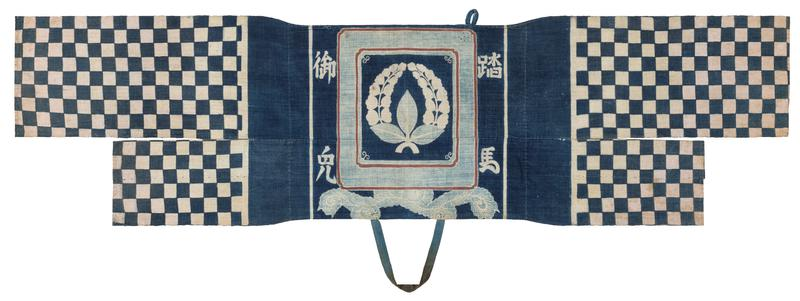 navy blue center, printed with floral ring inside rectangular frame, four characters in corners, and light blue leaves at bottom; one long and one short panel printed with blue and white checkerboard pattern attached on either side, not connected to each other; one blue strap attached at BC, one blue loop attached to center panel in UR