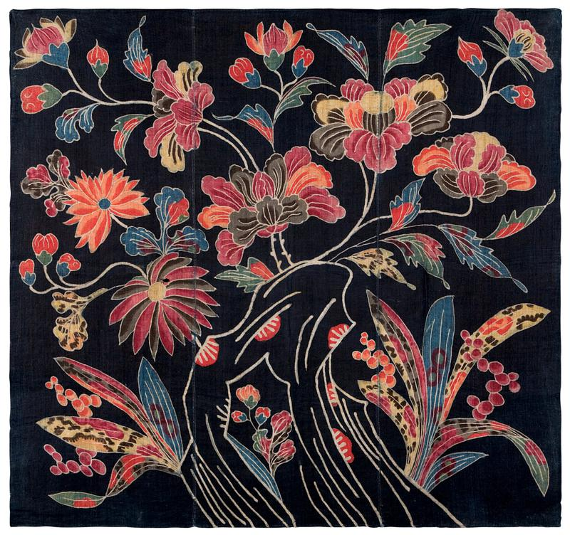 three vertical panels of dark blue fabric with multicolored floral design; spotted/patterned grasses, berries, and white accents in lower quadrants, with various types of flowers on curing white stems in upper sections