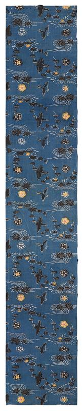 rectangular blue fragment of fabric with black, white, and yellow pattern; yellow flower blossoms scattered throughout black birds, leaves, and waves with white accents