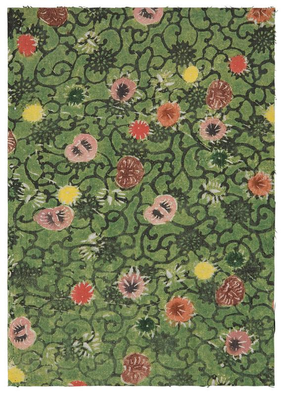 rectangular fragment of green fabric with dark vine pattern and pink, yellow, and red blossoms scattered throughout