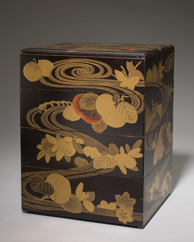 four stacking compartments with cover; decorated with fruits, leaves, and foliage with swirling parallel lines on each side; black with gold and orange-red; red interior