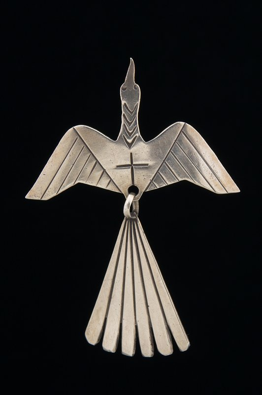 bird pin with wings extended; pointed beak at top; movable tailfeathers; tie tack pin with earring back