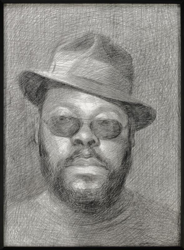 portrait of black man in sunglasses and slightly askew hat