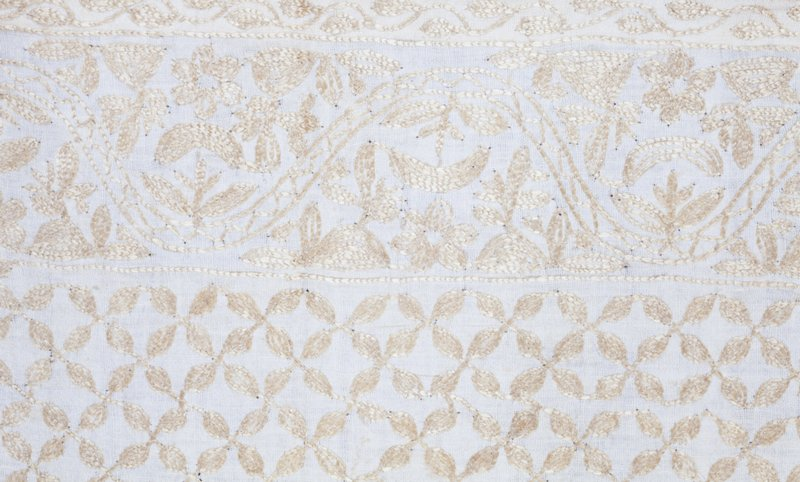 A cloth of Indian cotton embroidered with yellow silk. Chainstitch, done on a sewing machine.