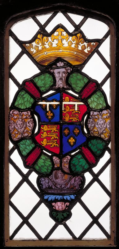 stained glass heraldic cartouche, containing the Arms of Edward, Prince of Wales, afterwerds King Edward VI (Quarterly France and England, a label of three points argent) within a wreath of green, ruby and purple; the latter that particular shade described as 'murrey', one of the livery colours of Prince Edward