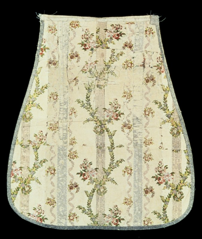 part of striped silk chasuble from a priest's vestment, Louis SVI design.; a flowing ribbon motif in metal thread both gold and silver over a cream background of heavy silk, much worn; a garland motive of delicate leaves in silver and pink flowers and knots of pink roses brocaded over the stripes completes the design