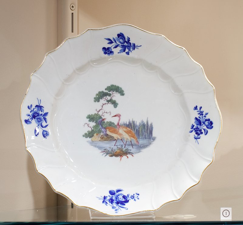plate, ceramic, white ground, blue sprays near edge, center panel of water birds, cat. card dims Diam. 9-7/8', H. 1-1/4'