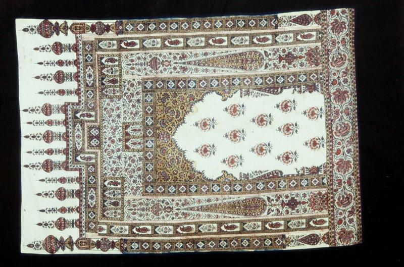 Prayer Mat; block printed cotton with design of prayer niche surmounted by minarets. Cotton.