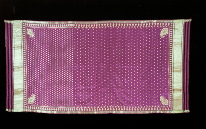 Sari; purple with border of palmettes in gols and small leaf motives in gold center.