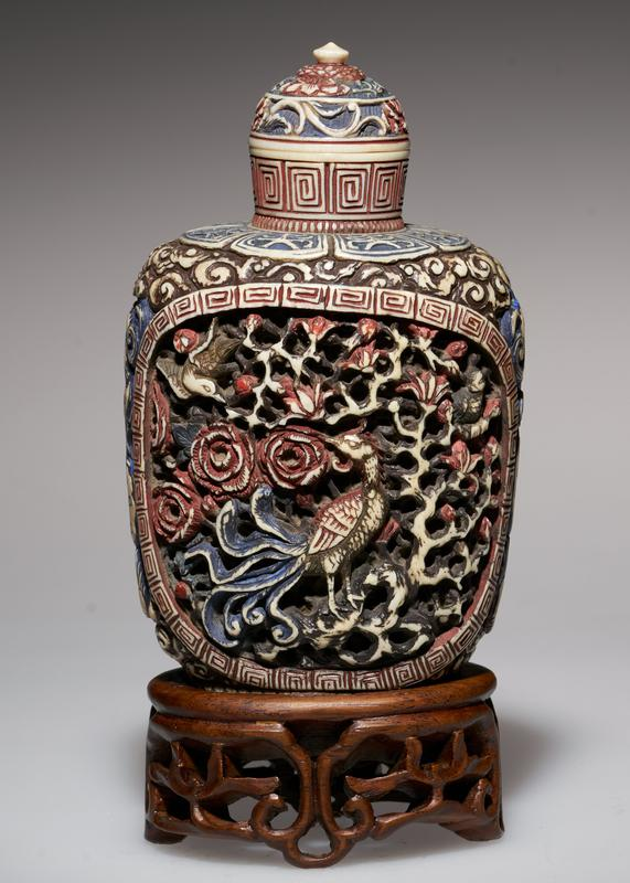ivory, carved and colored; ivory top; elaborate, deep carving; dragons on sides; two panels of birds and flowers