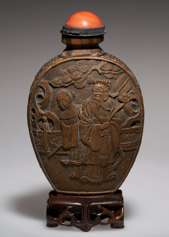 finely carved; sides inlaid with Mother-of-pear; carving depicts the sky, mountains, trees and river, a fitting spot for contemplation; symbol of ideal existence