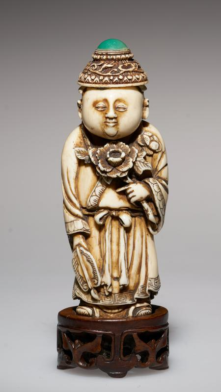 carved figure, with carved ivory cap for stopper, studded with jade green; peony in one hand, fan in the other