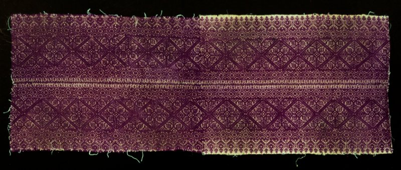 Two borders of purple embroidery joined with a woven stitch. Seam through the center. Pattern typical of embroideries made in the city of Fez. On linen.