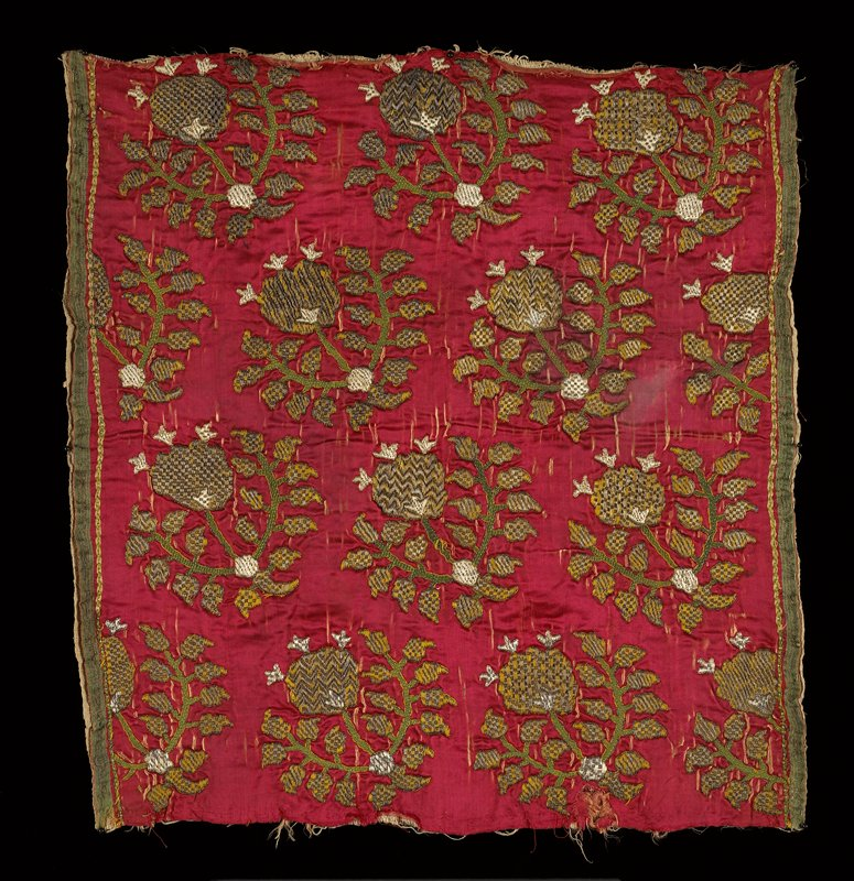 Embroidered square of red satin faced with coarse white cotton material and worked with metal threads and green silk in rows of conventionalized floral motifs. Unfinished at the top and bottom and finished at the sides with selvages. Satin.