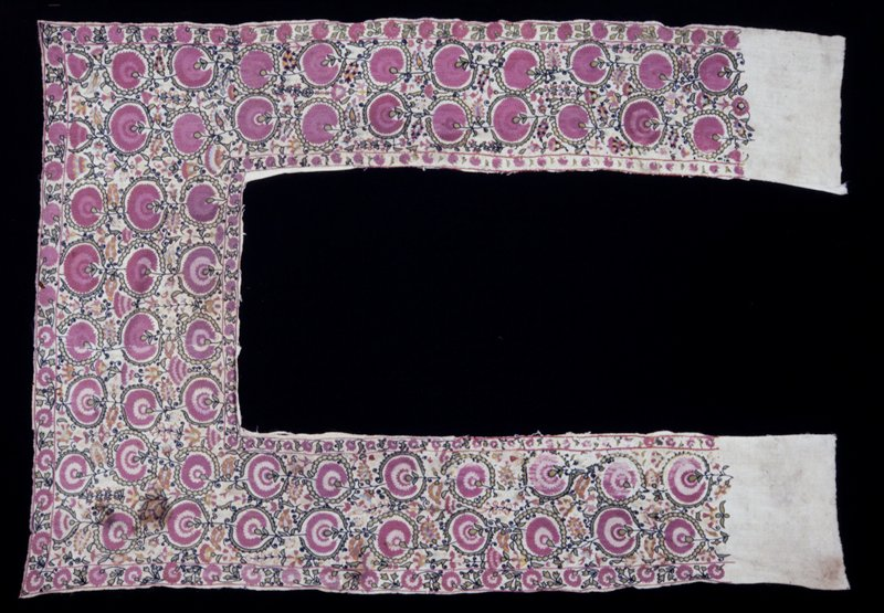 Heavy cotton bed curtain made in inverted U-shape. The side panels are embroidered with pairs of faded rose-colored flowers in brackets of narrow spiny leaves. The cross piece at the top is embroidered with three rows of similar design. Cotton, embroidered.