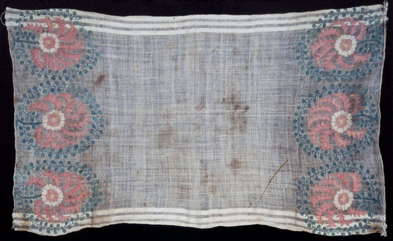 Towel of loosely woven linen material embroidered with silk thread in border at each end. Composed of three spiked pink flowers surrounded by circle of leaves and vine. Both ends are hemmed and both sides finished with three narrow borders of silk thread woven into the material. Linen.