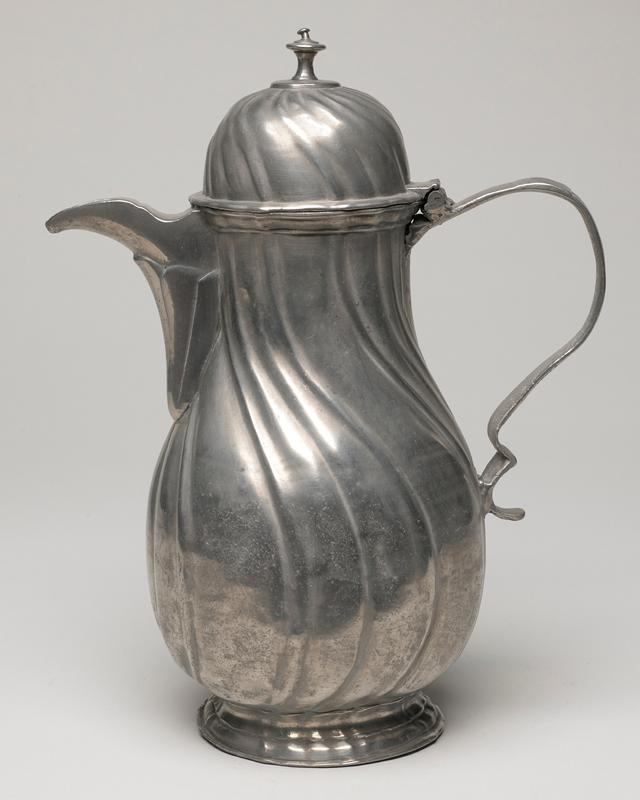 coffee pot, pear-shaped, of rococo design on round base; found finial, curved handle; spout set on straight