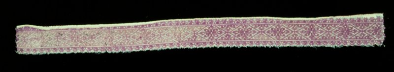 pillow border, embroidered in lavendar silk in a design of lozenges and geometrical flowers; Moorish diagonal and straight stitch; the edge is finished with buttonhole stitch