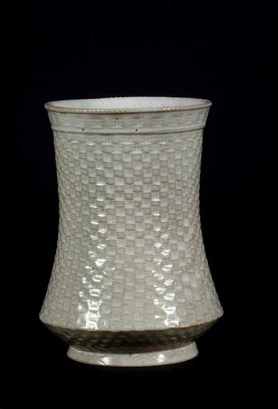 Vase, cylindrical, of basket weave pattern, greyish white.