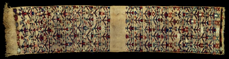 Tent hanging, part of, embroidered at each end with ten rows of conventionalized tree-in-pot design. Red, blue, green and white on a mustard colored background. Sides turned under; one end finished wit twisted warp fringe, the other with short loose warp fringe.