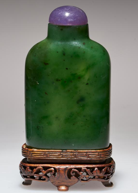 Snuff bottle, spinach green jade, amethyst top; stand.