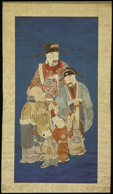 Scroll hanging of embroidered blue silk mounted in brocade border. The scene represents three taoist gods of Longevity, Shou-hsing (left); of Public office Lu-hsing (center); of Happiness, Fushen (right) with three boy attendants carrying objects of rank and authority. The embroidery and blending of colors is of high quality in this panel, which is said to have been purchased from the imperial collection.